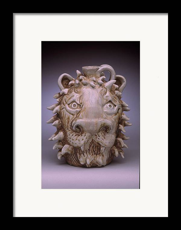 Face Jug Framed Print featuring the ceramic art Lion Face Jug by Stephen Hawks