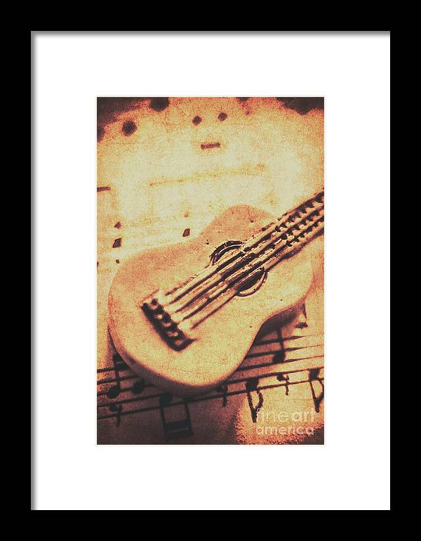 Folk Framed Print featuring the photograph Little Carved Guitar On Sheet Music by Jorgo Photography - Wall Art Gallery