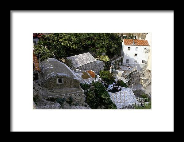 Houses Framed Print featuring the photograph Living On The Cliffside by Morris Keyonzo