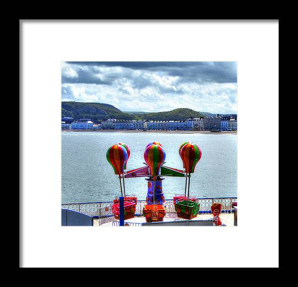 Ride Framed Print featuring the digital art Llandudno Fun For The Kids On The Pier by Chris Evans