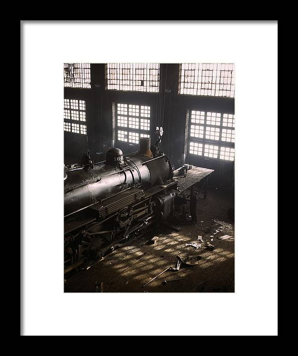 Locomotive Framed Print featuring the photograph Locomotive Repair Shop - December 1942 by War Is Hell Store