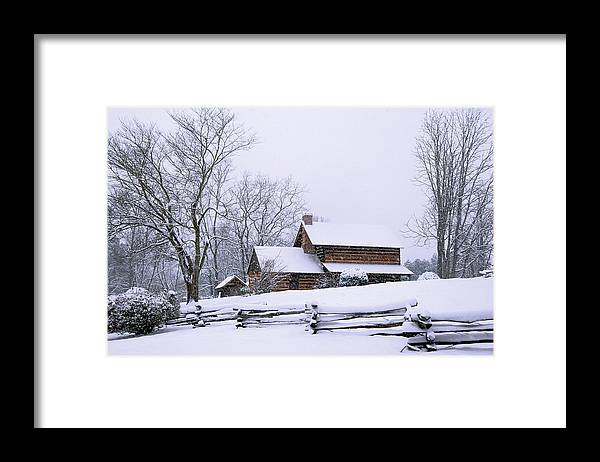 Log Cabin Framed Print featuring the photograph Log Cabin In Snow by Alan Lenk