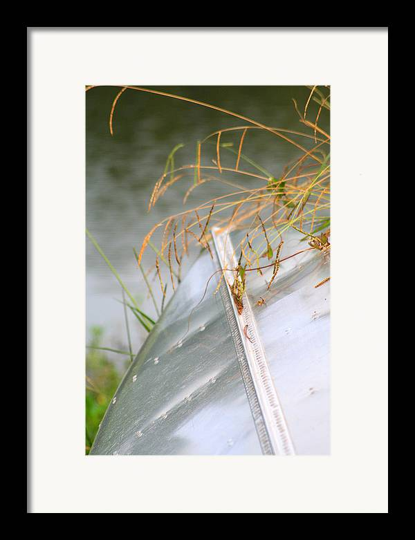Canoe Framed Print featuring the photograph Lone Canoe by Greg Sharpe