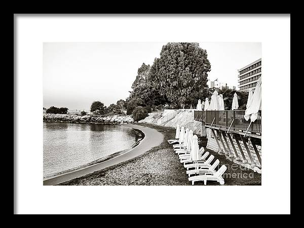 Lounge Chairs In Cyprus Framed Print featuring the photograph Lounge Chairs In Cyprus by John Rizzuto