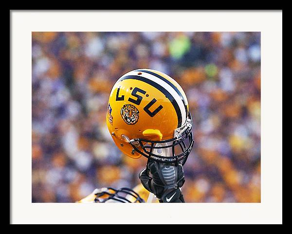 Lsu Framed Print featuring the photograph Lsu Helmet Raised High by Louisiana State University