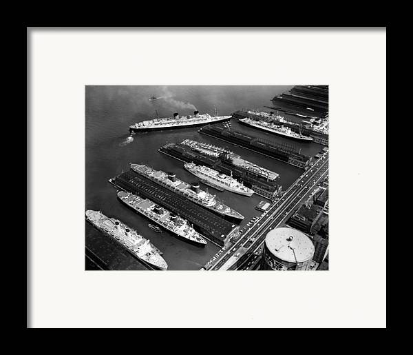 1960s Candids Framed Print featuring the photograph Luxury Liners Flanking An Aircraft by Everett