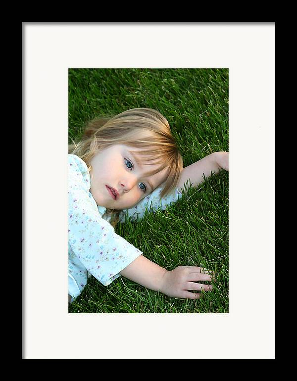 Girl Framed Print featuring the photograph Lying In The Grass by Margie Wildblood