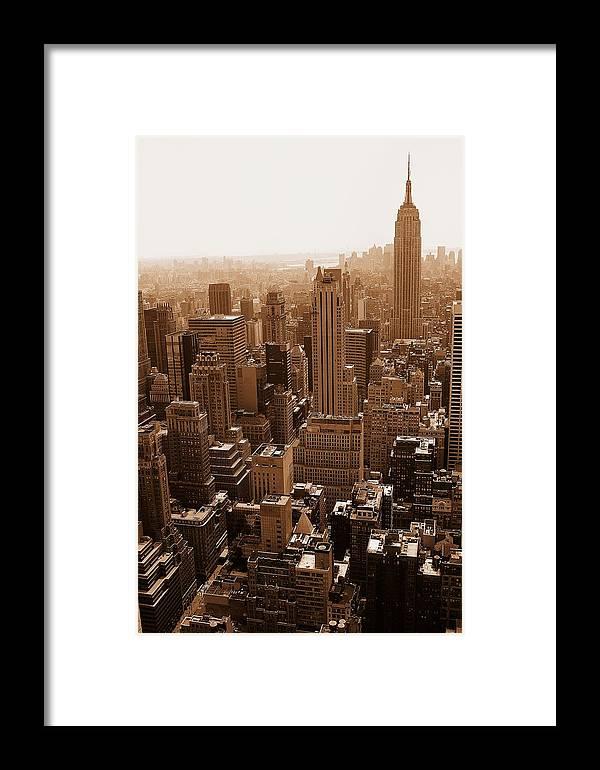 Cityscape Framed Print featuring the photograph Manhattan Aerial Sepia by Allan Einhorn