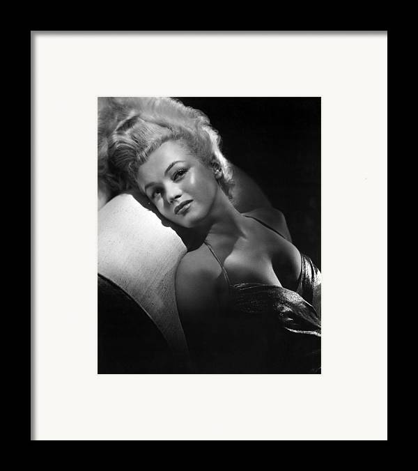 1950s Portraits Framed Print featuring the photograph Marilyn Monroe, Ca. Early 1950s by Everett