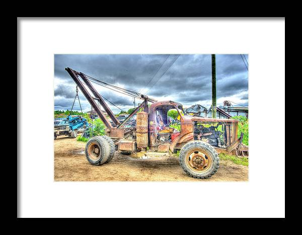 Junk Framed Print featuring the photograph Master-raider by Glenn Baja