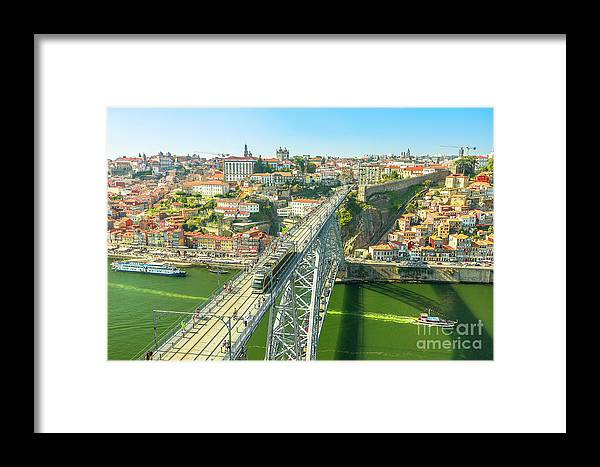 Porto Framed Print featuring the photograph Metro Train Over Porto Bridge by Benny Marty