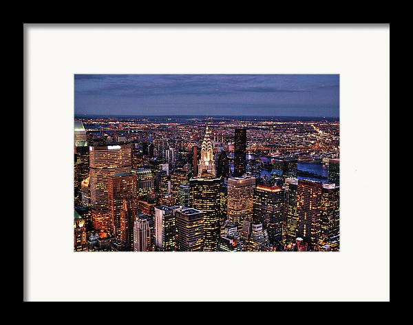 Manhattan Framed Print featuring the photograph Midtown Skyline At Dusk by Randy Aveille