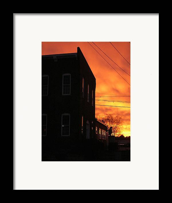 Orange Sky Framed Print featuring the photograph Millyard Sunset by Nancy Ferrier