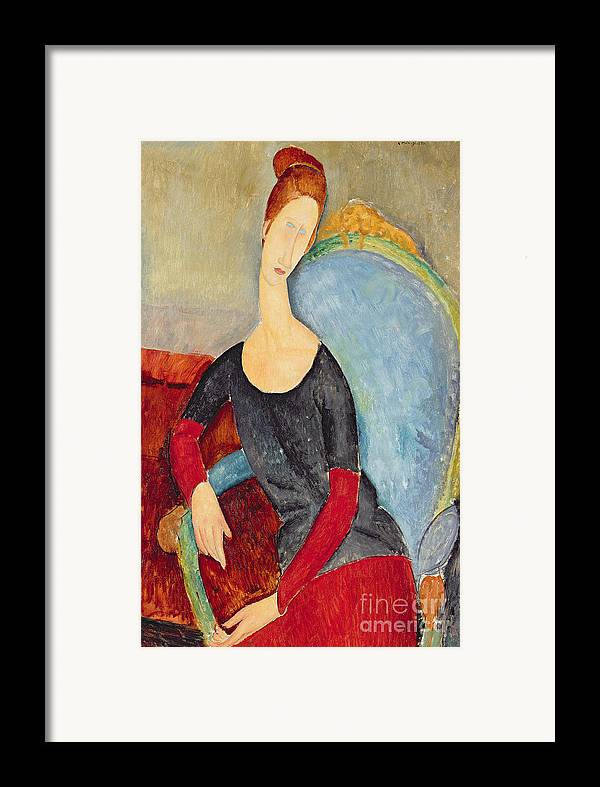 Mme Hebuterne In A Blue Chair Framed Print featuring the painting Mme Hebuterne In A Blue Chair by Amedeo Modigliani