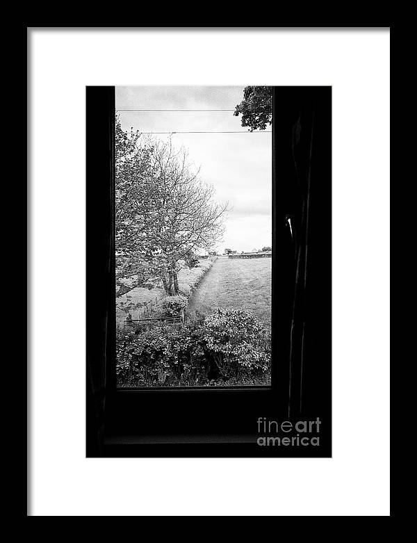 Carlisle Framed Print featuring the photograph modern window looking out onto rural fields in the lake district Cumbria England UK by Joe Fox