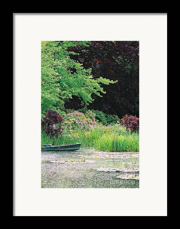 Monet Framed Print featuring the photograph Monet's Garden Pond And Boat by Nadine Rippelmeyer