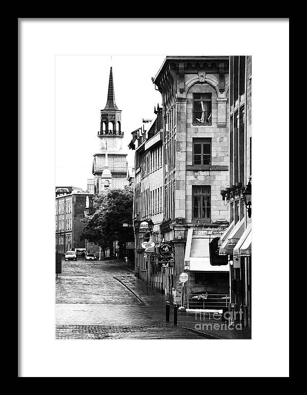 Montreal Street In Black And White Framed Print featuring the photograph Montreal Street In Black And White by John Rizzuto