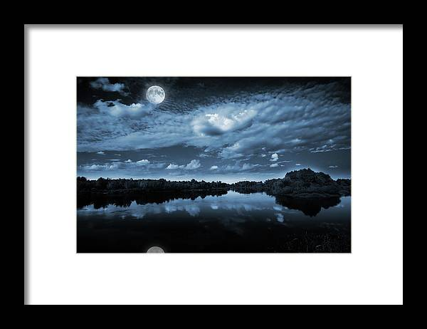 Beautiful Framed Print featuring the photograph Moonlight over a lake by Jaroslaw Grudzinski