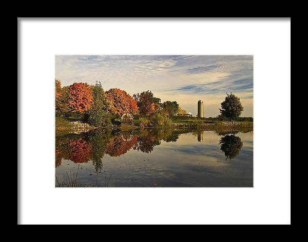 Autumn Framed Print featuring the photograph Morning Reflections Of Autumn Colours On A Farm Pond by Mark Emmerson