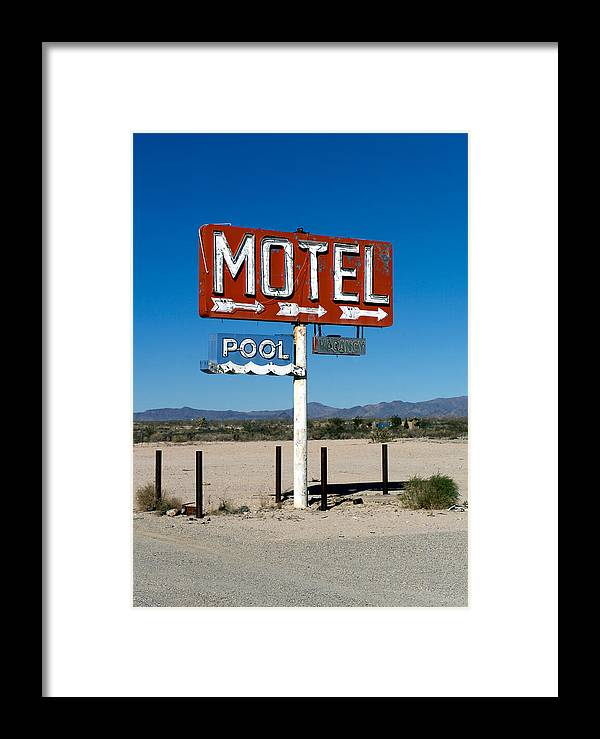 Route 66 Framed Print featuring the photograph Motel Sign On I-40 And Old Route 66 by Scott Sawyer