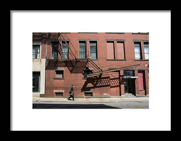 Street Framed Print featuring the photograph Moving Along by Jeff Porter