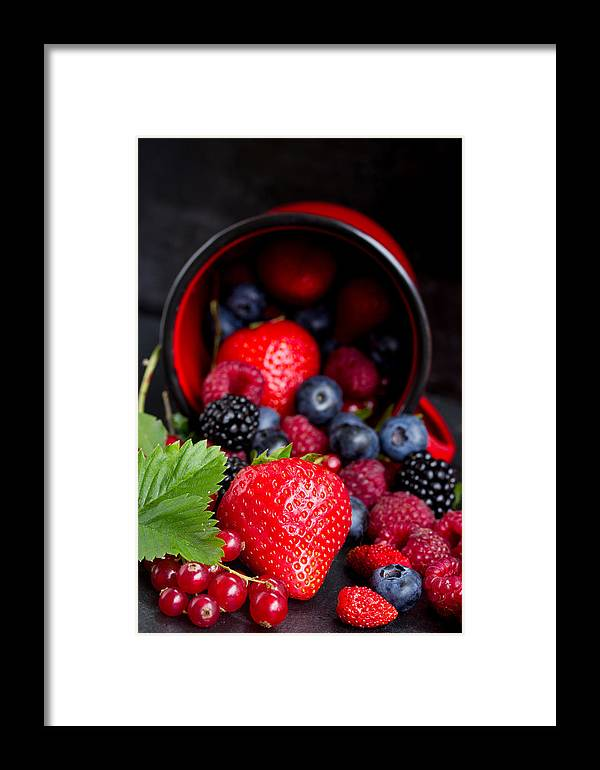 Currant Framed Print featuring the photograph Mug With Fresh Berries by Anastasy Yarmolovich