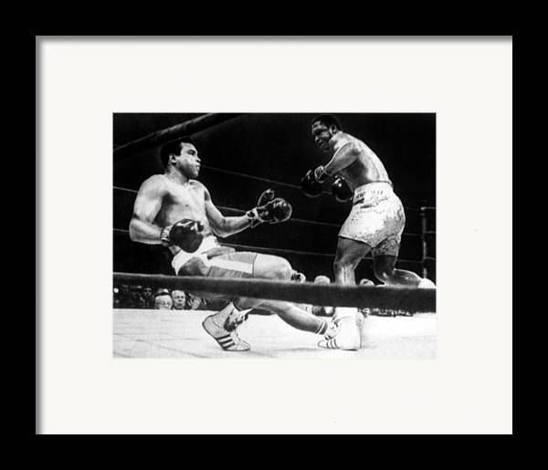 Ali Framed Print featuring the photograph Muhammad Ali Knocked Down By Joe by Everett