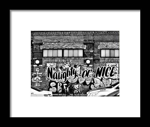 Graffiti Framed Print featuring the photograph Naughty Or Nice In B W by Rob Hans