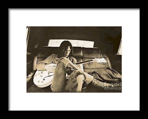 Neil Young In The Backseat Framed Print featuring the photograph Neil Young in the Backseat by John Malone