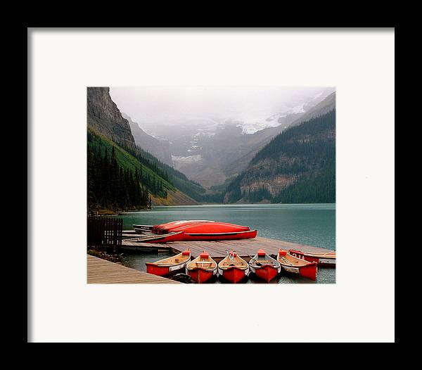Lake Louise Framed Print featuring the photograph Nestled Boat Launch by Diane Wallace