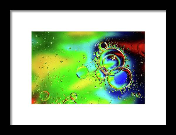 Macro Framed Print featuring the photograph New Year Bubbles by Steve Sullivan