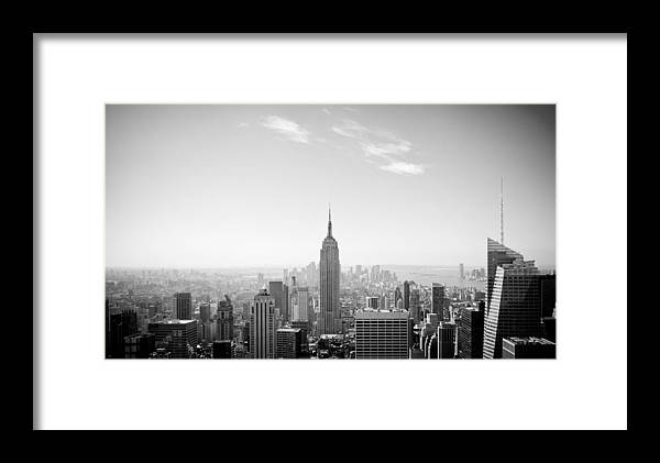 New York City - Empire State Building Framed Print featuring the photograph New York City - Empire State Building Panorama Black And White by Thomas Richter