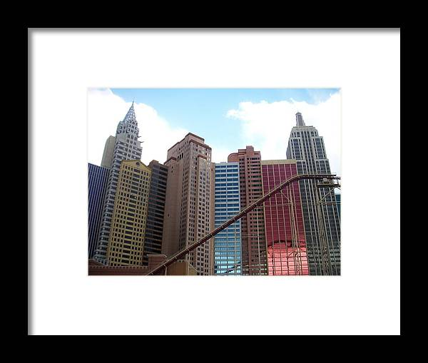 Vegas Framed Print featuring the photograph New York Hotel With Clouds by Anita Burgermeister