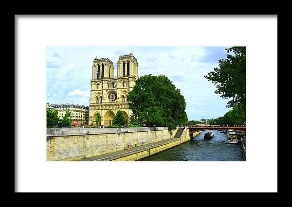 Notre Dame Framed Print featuring the photograph Notre Dame On The Seine by Kathleen Barngrover