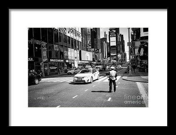 Times Square Framed Print featuring the photograph nypd traffic cop on Times Square New York City USA by Joe Fox