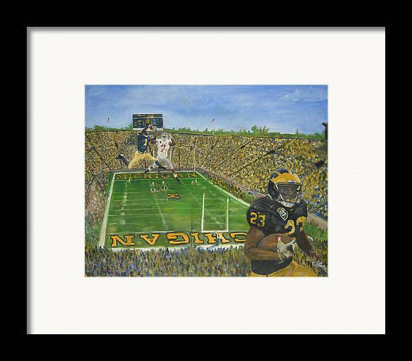 Michigan Framed Print featuring the painting Ohio State Vs. Michigan 100th Game by Travis Day