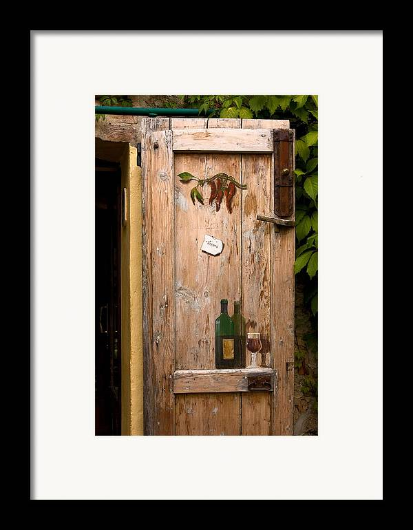 Old Door Framed Print featuring the photograph Old Door And Wine by Sally Weigand