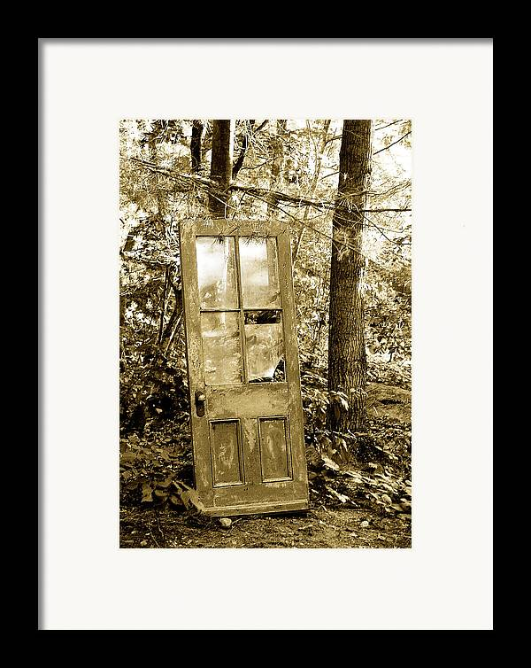 Broken Glass Framed Print featuring the photograph Old Door by Linda McRae