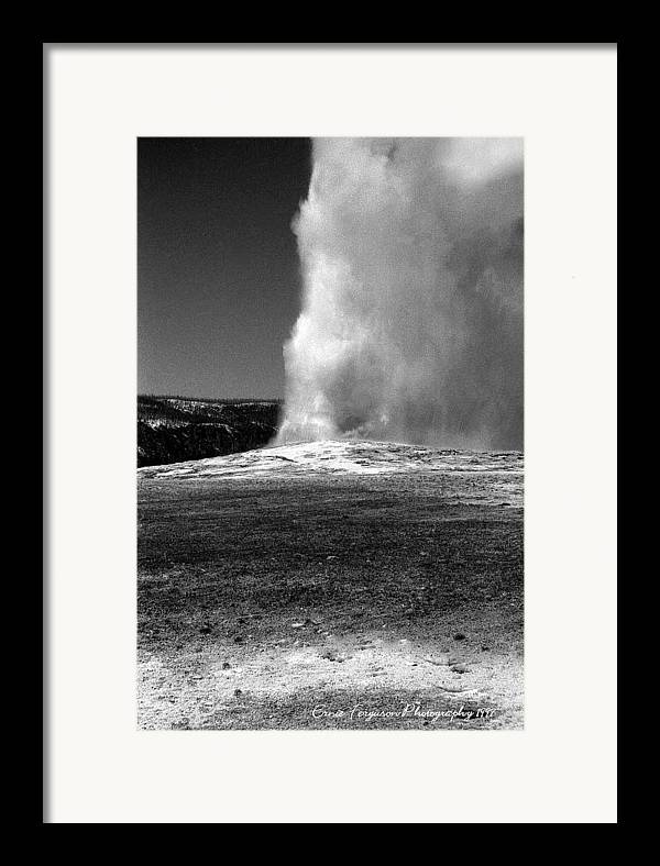 Landscape Framed Print featuring the photograph Old Faithfull In Classic Black And White by Ernie Ferguson