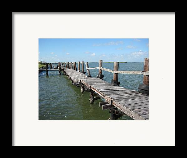 Marine Framed Print featuring the photograph Old Pier by Wendell Baggett