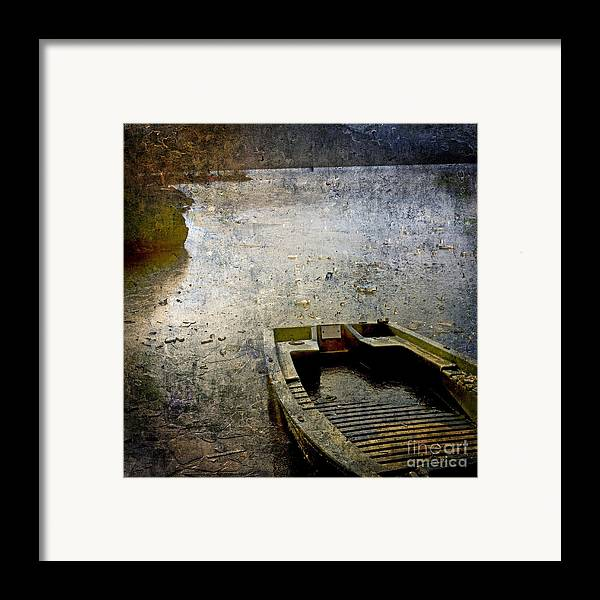 Bail Out Framed Print featuring the photograph Old Sunken Boat. by Bernard Jaubert