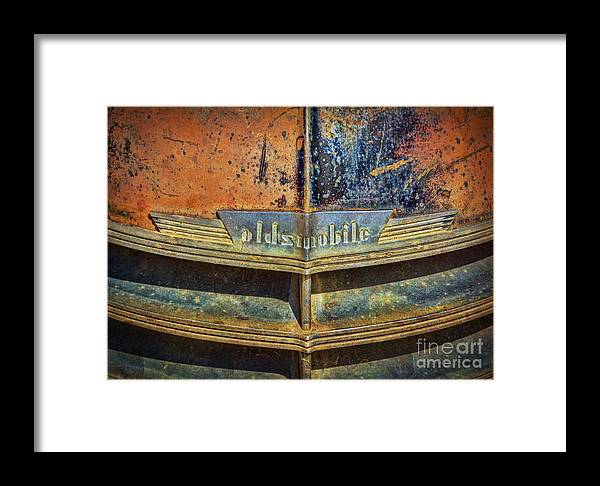 Abandoned Framed Print featuring the photograph Oldsmobile by Janice Pariza