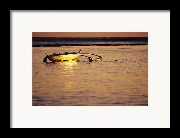 Aku Framed Print featuring the photograph Outrigger And Sunset by Joss - Printscapes