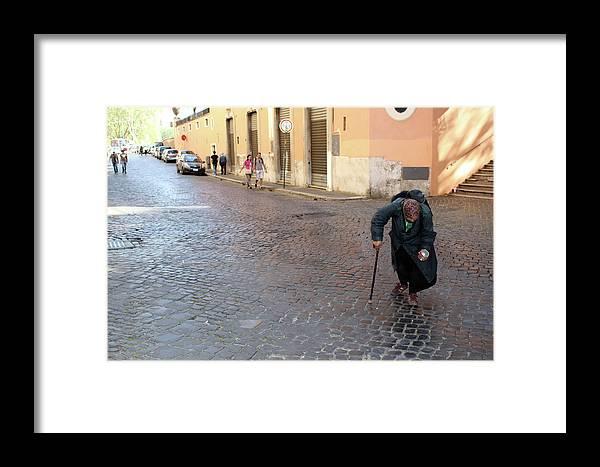 Panhandler Framed Print featuring the photograph Panhandler by Munir Alawi