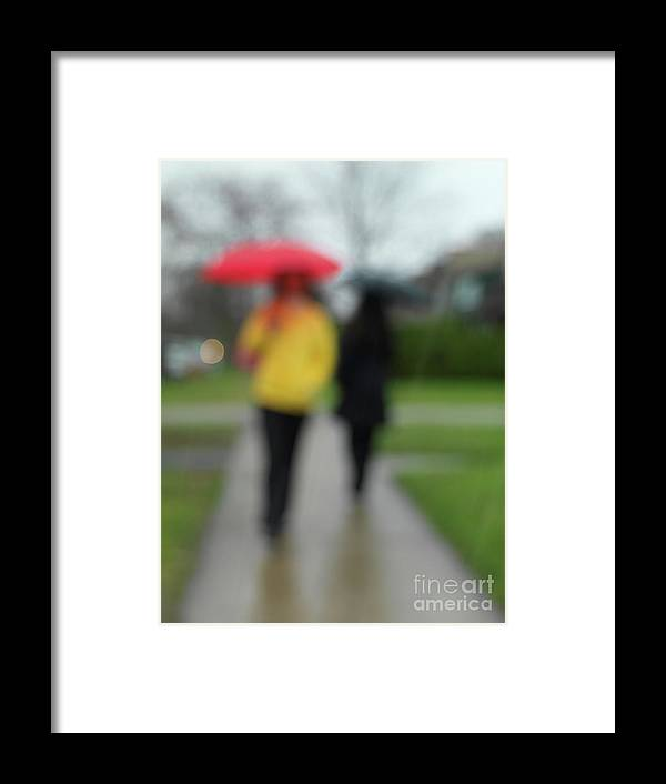 Rainy Day Framed Print featuring the photograph People In The Rain by Maxim Images Prints