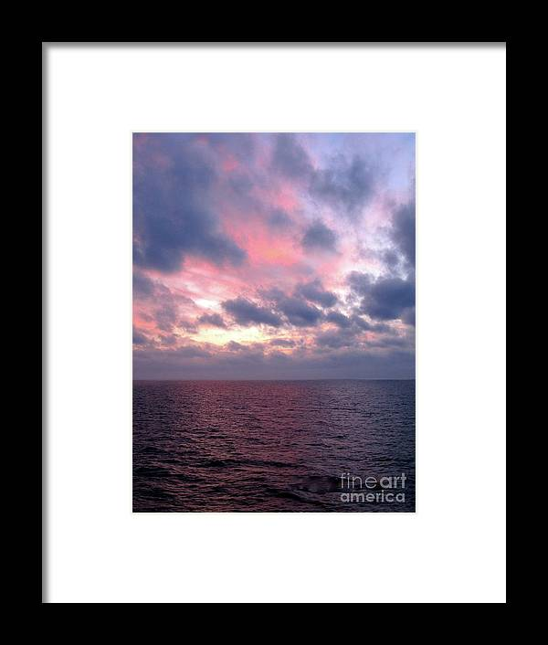 Pink Blue White Sky Framed Print featuring the photograph Pink And Blue Sunset In The Black Sea by Phyllis Kaltenbach