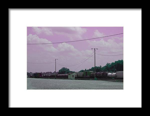 Trains Framed Print featuring the photograph Pink Sky And Trains by Corey Fields