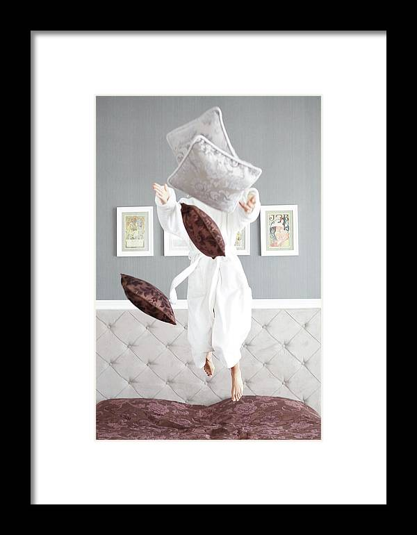 Bed Framed Print featuring the painting Playful Young Woman Jumping On The Bed , A Pillow Fight by Jan Pavlovski