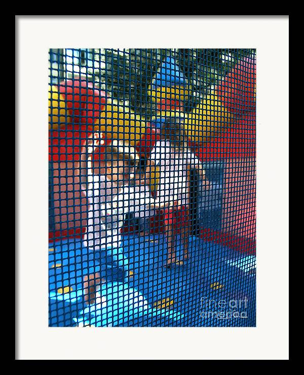 Child Framed Print featuring the photograph Playing Safe by Carlos Alvim
