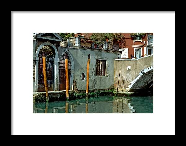 Venice Framed Print featuring the photograph Poles On Canal In Venice by Michael Henderson